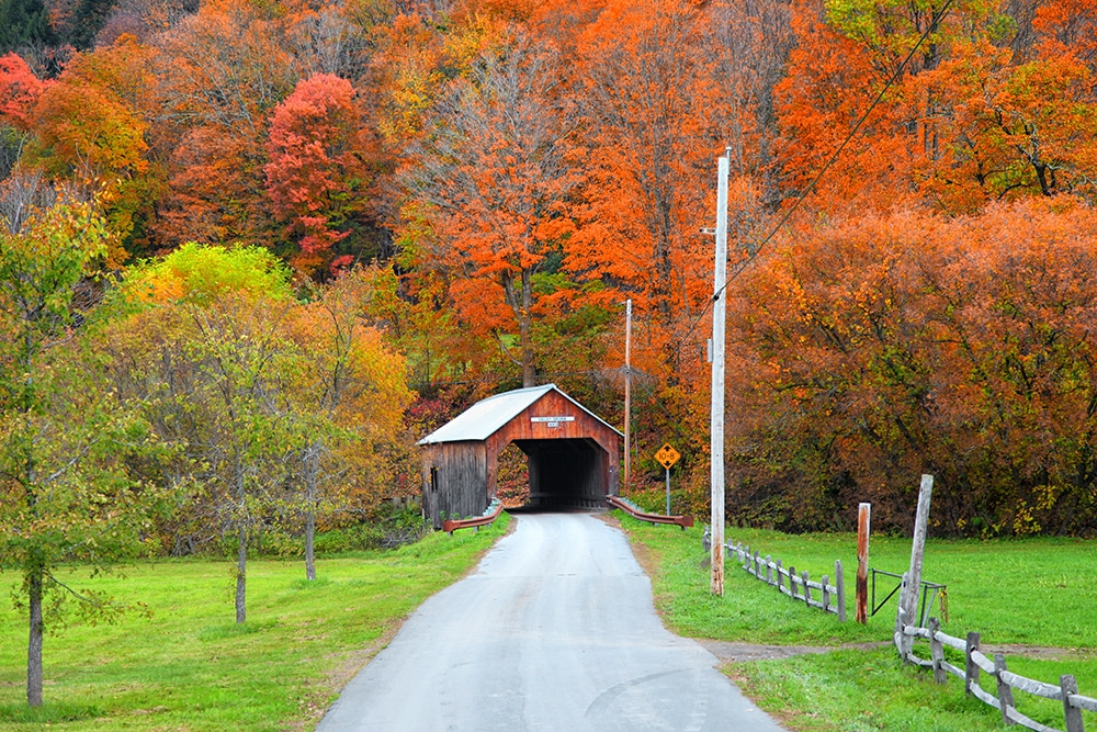 View of weathered covered bridge during the fall foliage