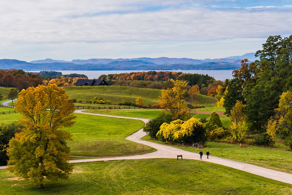 View of a park in Shelburne during the fall with Lake Champlain and the Adirondacks in the background